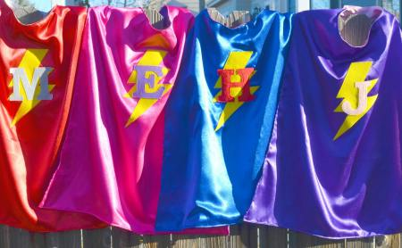 Handmade superhero capes in a variety of colors