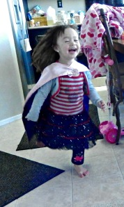 wearing her superhero cape from Jeni Lynn Designs